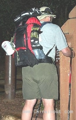 Rear view - tarps, compass, mug, para-cord, gloves, and fuel/water bottles all visible